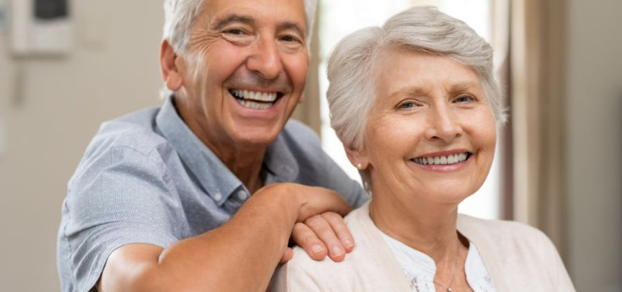 elderly white man and woman smile with relief given with elder law attorney in Strongsville, OH planning help